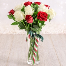 send xmas 12 red and white roses in glass vase to philippine